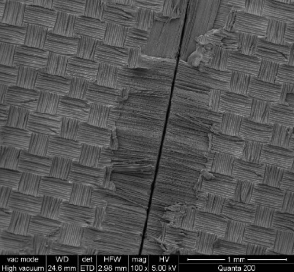 SEM of laser cut surface, showing slight surface thermal damage.